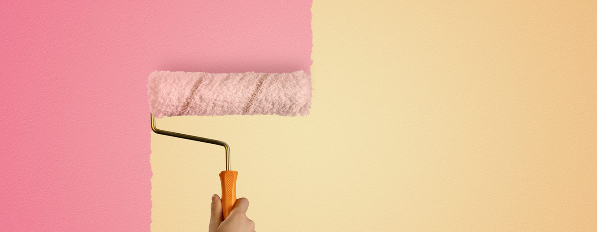Yellow wall being painted over with pink