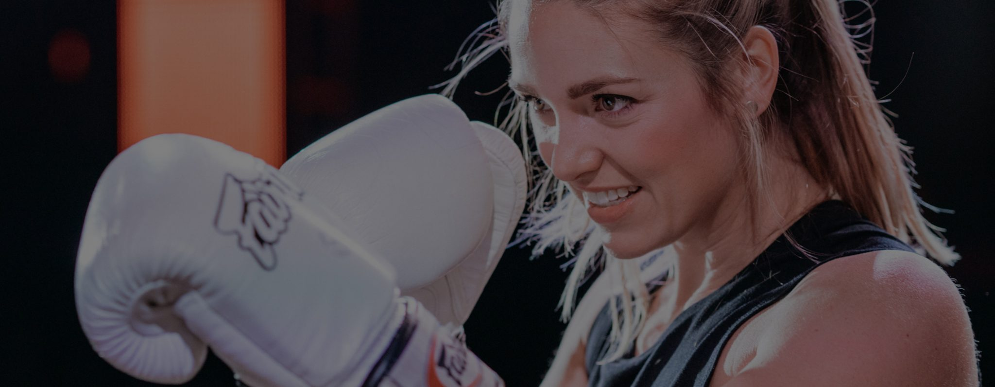 Female boxer prepping for a boxing fight for BASH