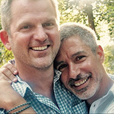 Picture of Gregg Glaviano and his husband Dan on his bio page.