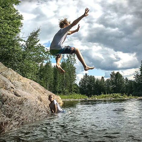 Photo of Johnny Vitorovich's children jumping into a lake on his bio page.