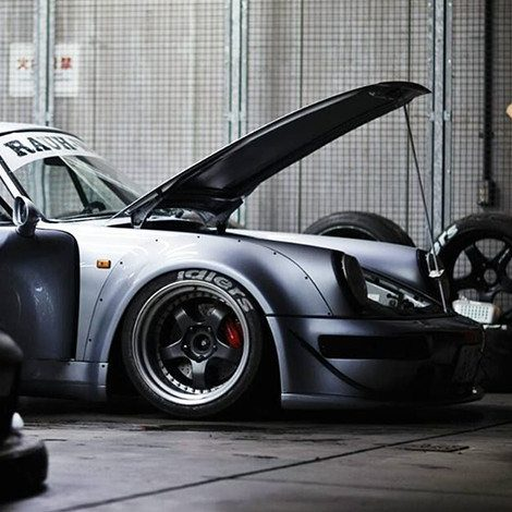 A custom Porsche with Idlers tires on his bio page.