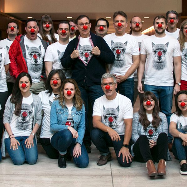 Grafik team wearing lama tshirts with red noses, while the employees were red noses