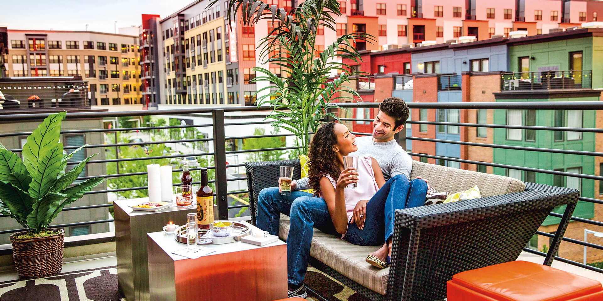 picture of couple sitting on a rooftop terrace