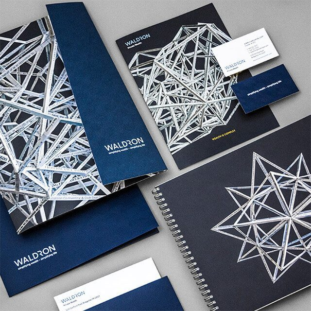 Waldron's rebranding efforts included incorporating the new design, logo, and mantra in day-to-day materials like folders and business cards.