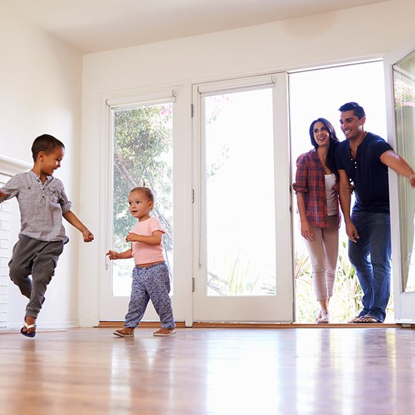 family playing with each other in their new home