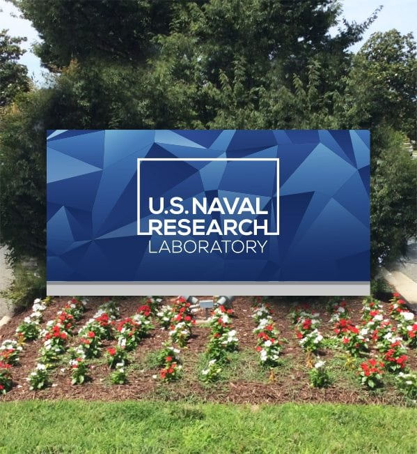 US Naval Research Lab Logo on board in a garden
